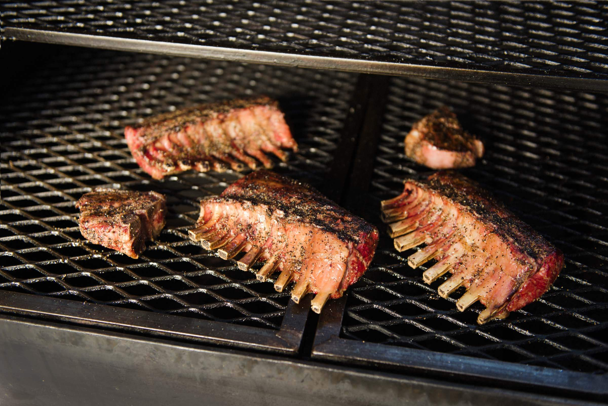 racks of lamb on the bbq grill